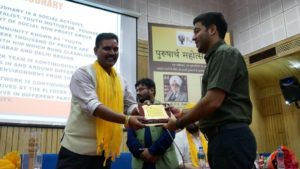 Mr Mayank Chaudhary receiving Purusharth Award
